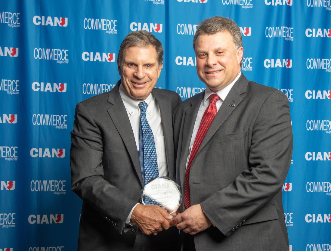 Michael McBride accepts Companies That Care Award from Tony Russo
